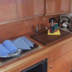 2 cabin motor boat charter formentera ibiza galley